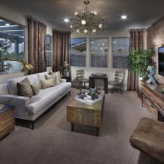 Your home is an expression of you. How do you make your decor unique? By adding fun throw pillows, a decorative chandelier or coffee table accents? Tell us in comments below. | Pulte Homes