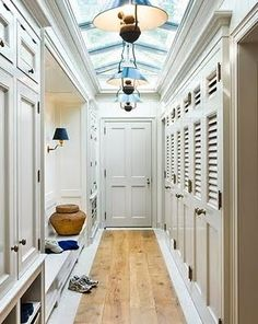 paint everything a matching white, hang a pendant light, and add more cabinetry in the other corner