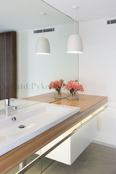Like the mirror splash back to the floor - so long as there is enough storage - timber and white is so classic