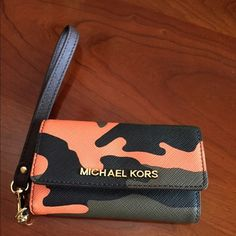 Michael Kors wristlet Adorable orange poppy and camouflage wristlet/ phone case with credit card slots and ID pocket. Fits IPhone 5/5S Michael Kors Bags Clutches & Wristlets