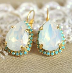 Crystal opal Turquoise earring - 14k plated gold  earrings real swarovski opal and  Turquoise rhinestones .. $52.00, via Etsy.