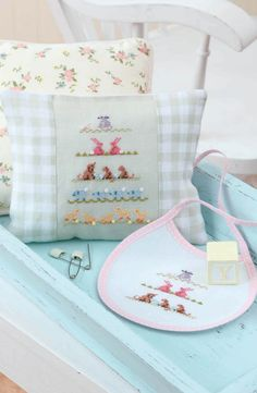 Sweet Nothings for Baby - Every baby deserves to have a sweet memento of his or her childhood. With these seven cross stitch designs by Judy Whitman, you can create something both mother and child will cherish for years to come. Fashion a framed piece, a christening album sleeve, or a pillow. For quick gifts, you can also work just a section of the charted designs on adorable little bibs. Special elements such as buttons, charms, and crystal embellishments add delicate dimension to the…