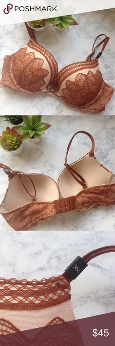 Push up bra 36C Lace Victoria's Secret brown rust New with tags! Retails for $60. Beautiful rust/ brown Lace over cream soft bra. Has underwire. Push up bra, very padded. Victoria's Secret Intimates & Sleepwear Bras