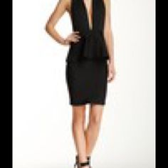 WOW Couture Peplum Dress NWT. Black Peplum Dress. Stretchy Fabric. WOW couture Dresses Midi