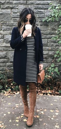 Like everything except don't like boots over the knee. Can't tell if it's navy or black. Don't like too much black near my face.