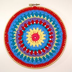 Beautiful color!  This crocheted Mandala is designed by Karen Janine! Free pattern!
