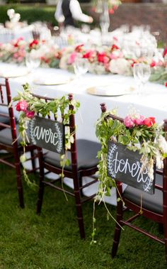Personalized Bride and Groom Ideas: Italian chair signs with draping greenery.