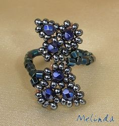 Lovely ring from Melinda - good use of memory wire (?) and nice leaf motifs.