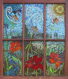 "garden View 1  ""Garden View"" was created with hand cut stained glass, glass gems, beads and pebbles directly applied to a 26"" by 32"" vintage window. Mosaic artist - Victoria Gilpin, Toledo, Ontario"