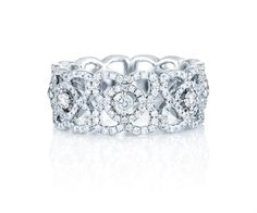 Enchanted Lotus Band from DeBeers [Sweet Jesus, I love this ring... It's insanely expensive though lol]