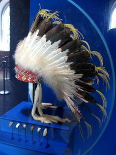 "Early 20th Century Plains First Nations Headdress at the Tower of London - From the curators' comments: ""Worn by Plains Indians tribes such as the Blackfoot, this is a feathered war bonnet with mounted eagle feathers over a leather skull cap. Four ermine skins hang loose two over each temple."" ~Photo Credit Kita Inoru"