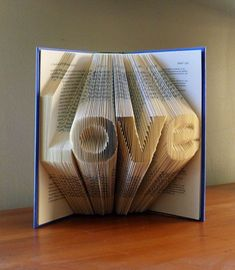 Paper Anniversary LOVE Folded Book Sculpture by Luciana Frigerio First Anniversary Gifts, Paper Anniversary, Boyfriend Anniversary Gifts, Boyfriend Gifts, Wedding Anniversary, Folded Book Art, Paper Book, Book Folding, Paper Art