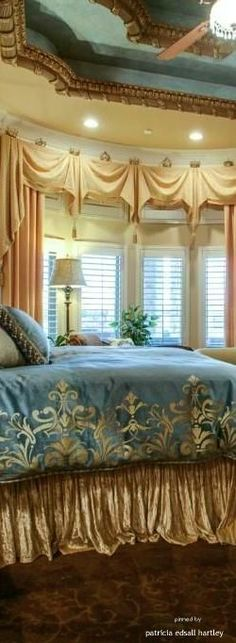 Beautiful Master Bedrooms.THIS SUMPTUOUS MASTER BEDROOM IS PERFECT IN EVERY WAY.THE LUXURIOUS BEDDINGS COLORS ARE USED ON THE ARCHITECTURAL DESIGNED CEILING AND THR DRAPES/CURTAINS ARE A GORGEOUS ACCENT.KEEPER.CHERIE