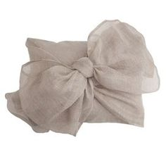 """Linen and cotton-blend boudoir pillow with oversized bow accent.   Product: Pillow   Construction Material: Linen and cotton cover and polyester fill   Color: Flax        Features: Insert included        Dimensions: 16"""" x 20""""      Cleaning and Care: Machine washable"""
