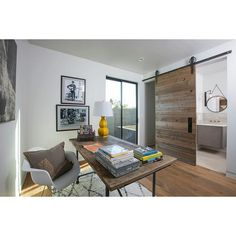 Sliding barn door separates home office from the other area. #rumahkuhomeoffice