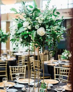Tall Lush Greenery Centerpiece with Gold Stand featuring Italian ruscus, nagi, fern, roses, and pillar candles. Allie Siarto & Co. Eucalyptus Centerpiece, Greenery Centerpiece, Candle Wedding Centerpieces, Floral Centerpieces, Wedding Decorations, Flower Arrangements, Fern Wedding, Floral Wedding, Wedding Crafts
