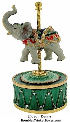 CAROUSEL ELEPHANT MUSIC BOX....the elephant's trunk facing up is always good luck.