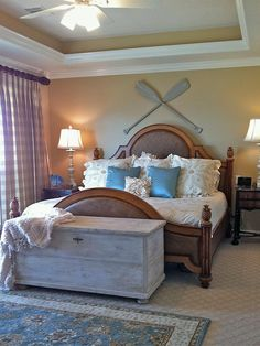 Vintage Focal Point - Coastal-Inspired Bedrooms on HGTV.  Neutral base with colorful accents.