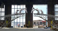 In September, specialized 3-D printing robots will spend two months assembling a pedestrian footbridge, with no human hands needed in the actual labor.