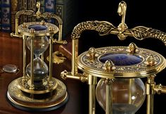 The Mariner's Hourglass A striking detailed hourglass fashioned after those used to keep time for a ship's watch centuries ago. Made of precision die cast material and plated with 24 karat gold. Measures 9 inches in height. Hourglass Sand Timer, Fantasy Rooms, Sand Glass, Hourglass Fashion, Sand Timers, Goth Home, Character Poses, Steampunk Necklace, Travel Style