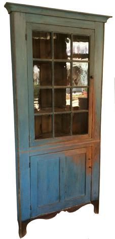 X81 Early 19th century Corner Cupboard with wonderful old blue paint, nice high scalloped cut out design base which is painted black , the wood is yellow pine, single door with twelve window lites