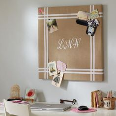 Could DIY a board like this with burlap or linen and ribbon. I like the way they used the ribbon, something other than the usual diamond pattern