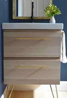 IKEA vanity with added hairpin legs for looks not function