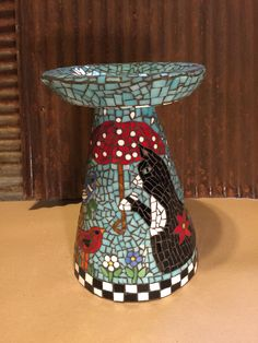 Small handmade birdbath made of hand cut stained glass.  Cat in the company of little bird friends.  All products are my own work and not to be replicated...by Rhonda Kretzer Studio