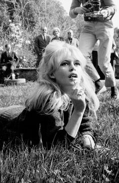 """""""A photograph can be an instant of life captured for eternity that will never cease looking back at you."""" - Brigitte Bardot"""