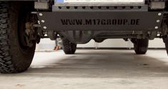 Land Rover Defender Unterfahrschutz mit Werbelogo M17Group