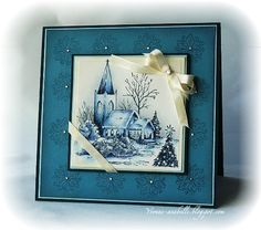 Beautiful card.  Like the way the ribbon was used as well as the blue!