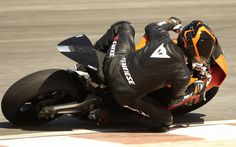 motorcycle racer. always amazes me how low they get to the ground