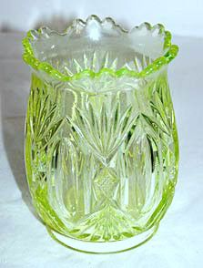 Here is an Early American Pattern Glass spooner in the Derby pattern made by Riverside. They only made a few patterns in the vaseline color and Derby is one of them. This spooner stands 4.75 inches ta