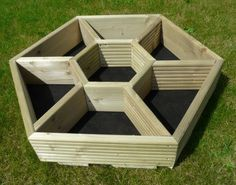Hexagonal hand made garden and patio planters. by patioplanters