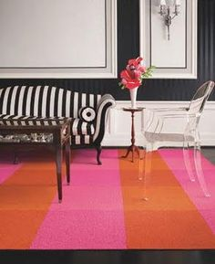 Oversized stripes. Black and white striped sofas. Love pink and orange!