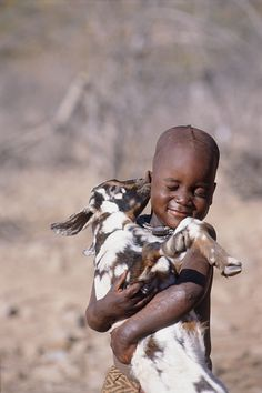 """""""Kiss, kiss"""" -- A Himba boy in Namibia, Africa gets a sweet smooch from his pet goat. Kids Around The World, People Around The World, Precious Children, Beautiful Children, Cute Kids, Cute Babies, Little People, Animals For Kids, Belle Photo"""