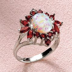 pretty ring, I love opals and garnets. Also I think that while I never really care that a stone is imitation, I love imitation opal, it's sparkly-er than real opal.