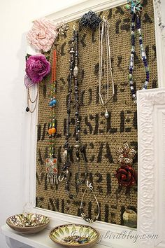 Attach burlap to an old frame to help organize your earrings.