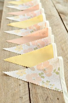 Vintage Bunting Banners would even be cute over the dance floor? These are really easy to duplicate... Just cut fabric with pinking shears and sew on binding tape for top.