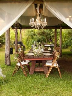 The chandelier in this outside cabana sure makes it feel like you're on an African Safari. Add a perfect touch of opulence for a very special backyard/garden party.