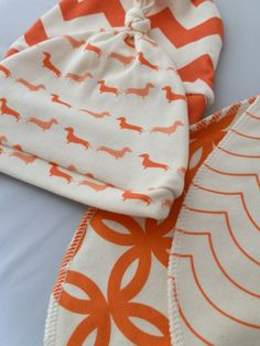 Hip Baby Gift Set, Knotted Baby Hats and Bibs Set, Organic Cotton in Oranges and Corals. $49.65, via Etsy.
