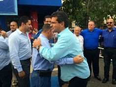 Rep. Pedro Pierluisi hugs a supporter outside the offices of his pro-statehood party.