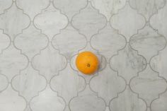 Arabesque Italian Carrara Marble Tile by Steinzeit. We used it for our bathroom floor but it works equally well on walls and kitchen backsplashes.