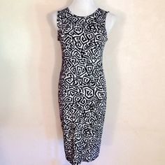 ASOS Black and White Sleeveless Dress. Sz 6. ASOS Black and White Sleeveless Aztec Dress. Sz 6. Length 37 inches. Armpit to armpit width lying flat 16 inches but stretches to 20 inches. 96% viscose and 4% elasthanne. ASOS Dresses Midi