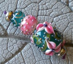 Pink Teal Floral Lampwork Beads by Cherie Sra R114 Flameworked Floral Focal Beads Pink Enamel Pink Floral Silver Glass Dots Encased Bead by CherieRanfranz on Etsy