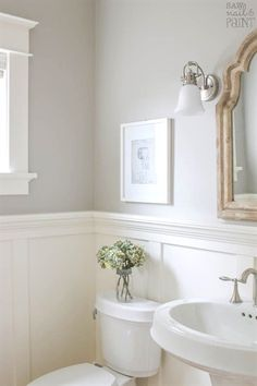 A pretty and fresh whole home paint color scheme using warm neutrals and calming blues. See photos of the paint colors used in actual rooms. #BathroomRenovationIdeas
