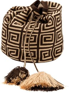"Brown hand-woven cotton handbag from Mochila featuring a thick shoulder strap, multicolored triangle knit design throughout, and top drawstring closure with tassel details. Measures approx. 10.5"" H x 9"" W x 7.5"" D"