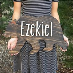 Welcome to my shop! We are a husband and wife shop that makes custom wood signs and string art! Each piece is made to order and hand crafted from start to finish. We cut, sand, stain, and paint each one by hand! Woodland custom name Bear Wood Sign. Rustic Nursery decor for a