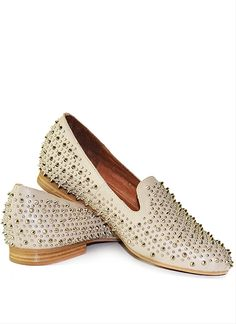 This gorgeous and comfortable loafer features all-over silver spikes and studs.