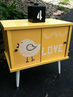 Love the yellow.  Love the bird. Great idea for a second hand furniture find